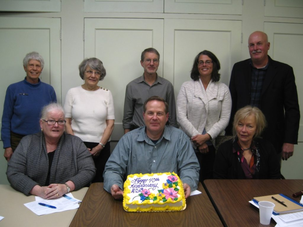 Board members celebrate ANSR's 40th anniversary in 2013.