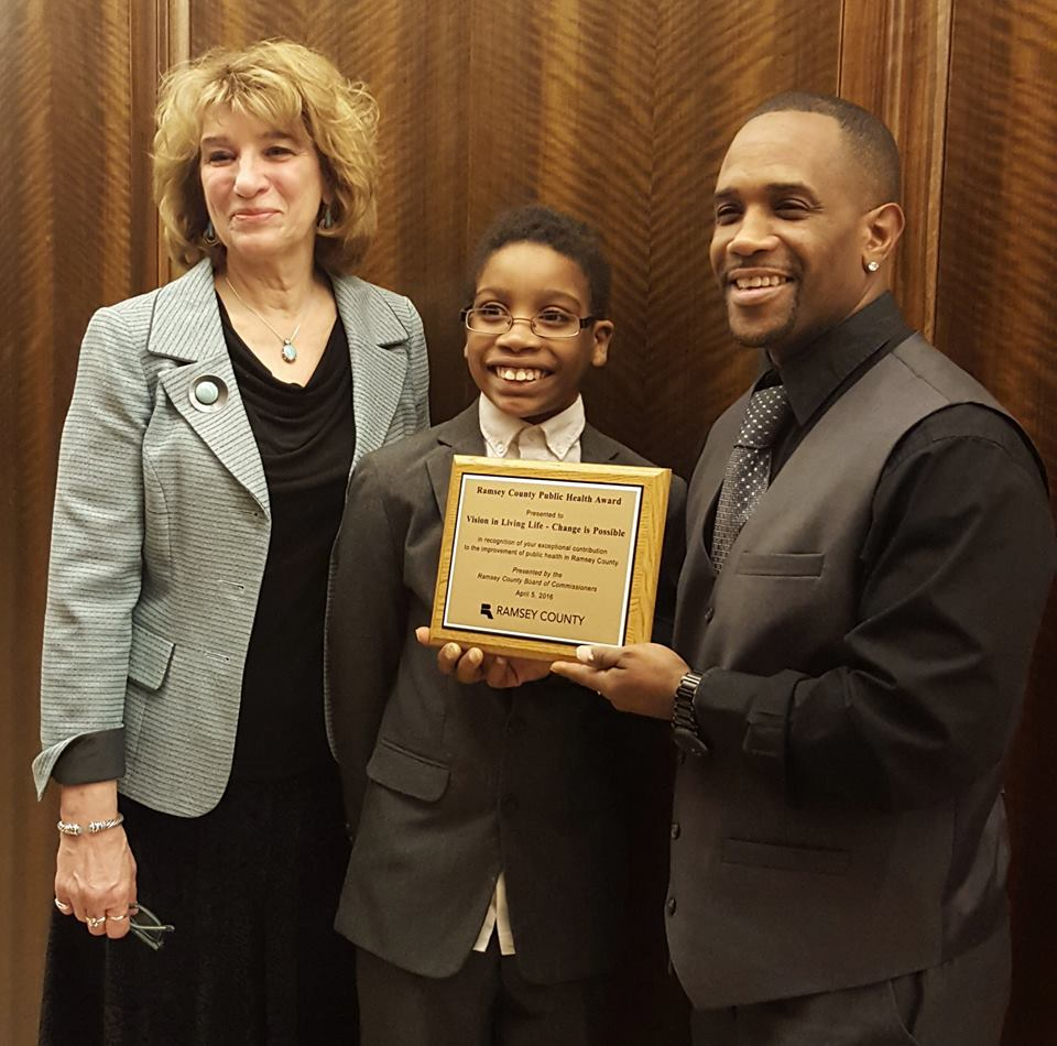 The youth group Vision in Living Life - Change is Possible receives a Saint Paul-Ramsey County Public Health award in April for their activism in Saint Paul. Pictured are Saint Paul-Ramsey County Public Health Director Rina McManus, VILL youth William Williams and VILL director Damone Presley.