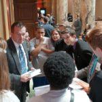 Tartan High School students meet with Rep. Lillie.