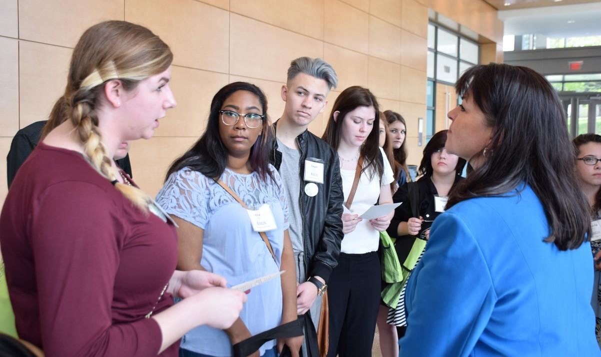 Tartan High SADD member Lexi Bacon talks with Sen. Susan Kent about the harms of tobacco.