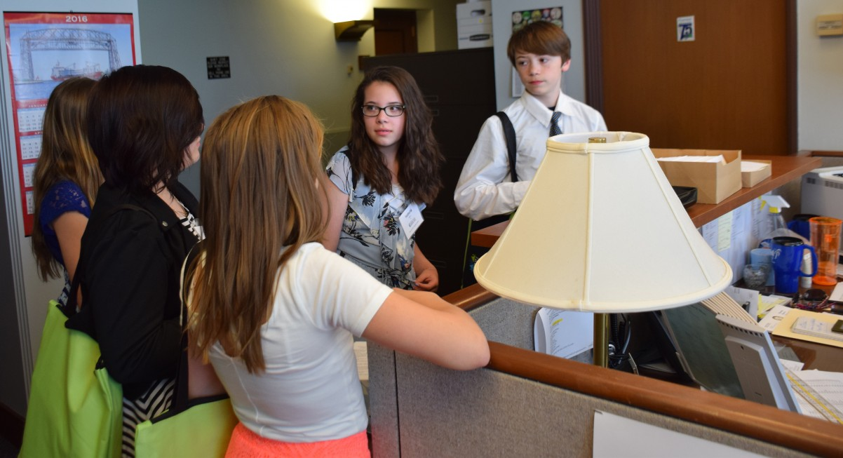 Youth from John Glenn Middle School talk about the harms of tobacco to the legislative assistant for Rep. Peter Fischer.