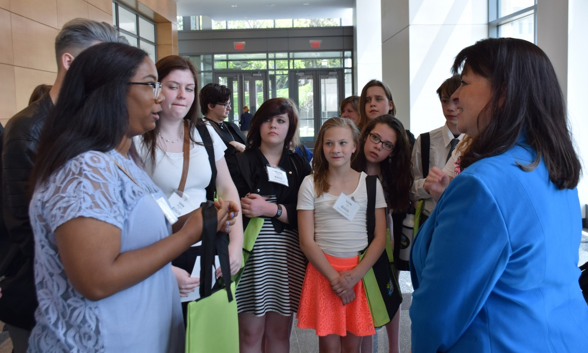 Tartan High SADD member Kira Rivers talks with Sen. Susan Kent about the harms of tobacco.
