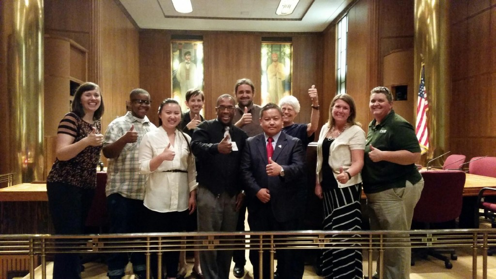 Program members, including director Damone Presley, celebrate an ordinance in Saint Paul that increases the price of cheap, flavored cigars.