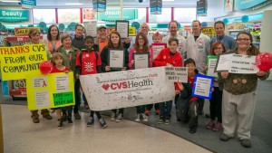 Students and staff from John Glenn, Maplewood and Skyview middle schools present a banner to CVS thanking it for removing tobacco products.
